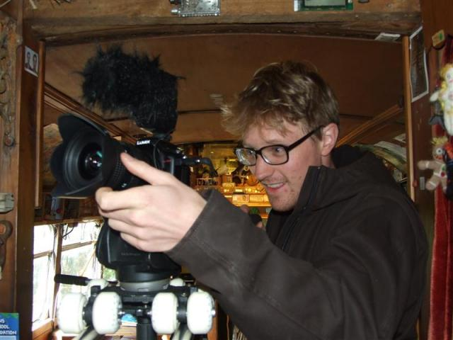 Dunedin film-maker Joey Bania films inside Blair Somerville's Lost Gypsy Caravan in Papatowai....