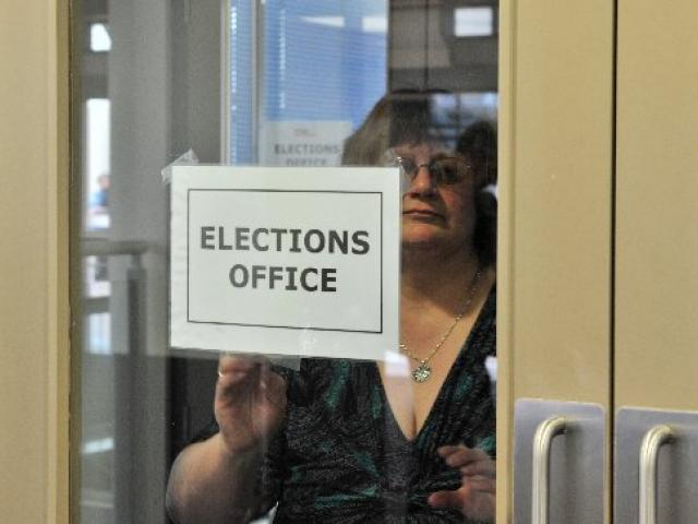 Dunedin returning officer Pam Jordan takes down the elections office sign  at the DCC at noon...
