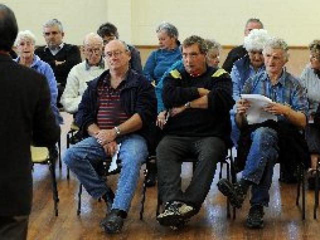 Former Dunedin mayor Peter Chin runs a meeting at Wingatui Hall last night to discuss its future....