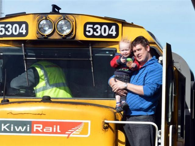 Keiran Harper and his son Oliver (20 months) aboard KiwiRail's exhibition express,  which visited...