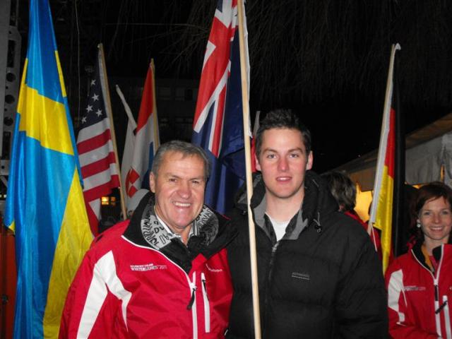 Minister of Major Events Development David Carter holds the New Zealand flag with New Zealand...