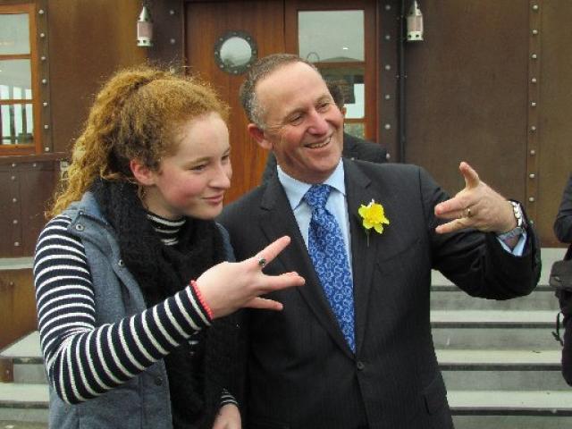 Nadia Kerr (16), of Oamaru, teaches Prime Minister John Key a ''Westside'' gesture. PHOTO: David...
