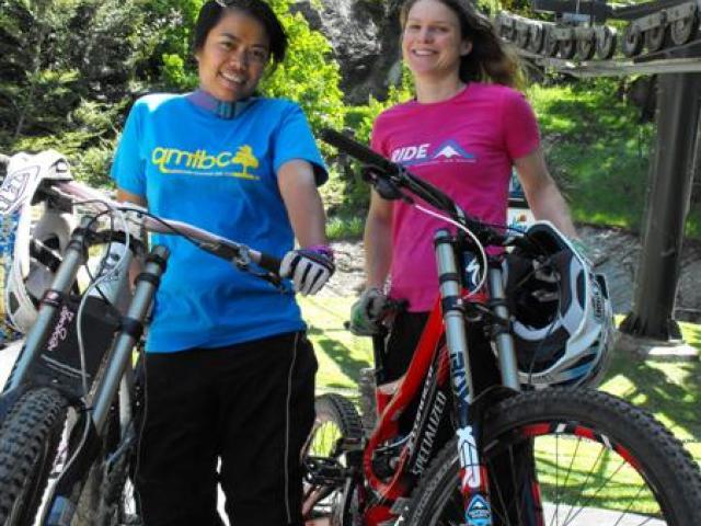 Outside Sports' Naomi Wilson and Queenstown Mountain Biking Club secretary Indri Clendon stand...
