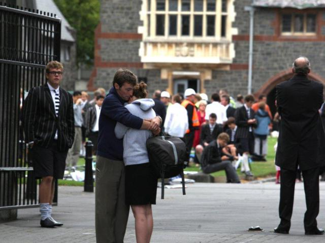 Pupils at Christs College comfort each other. Photo: NZPA / Ashburton Guardian, Kirsty Graham
