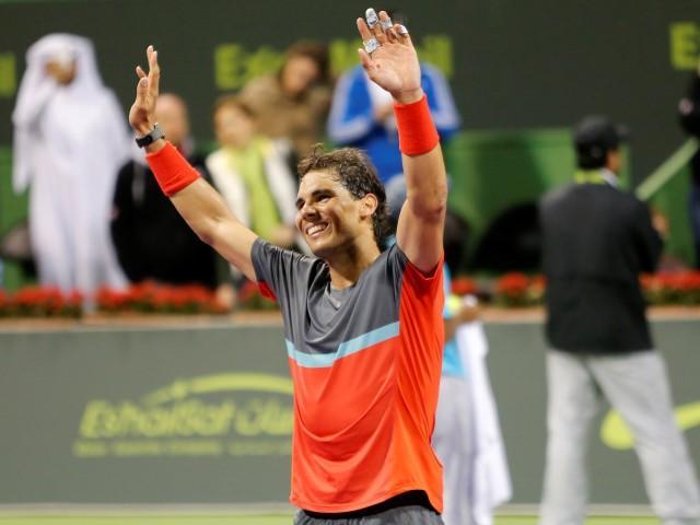 Rafael Nadal celebrates his victory in the Qatar Open final. REUTERS/Ahmed Jadallah