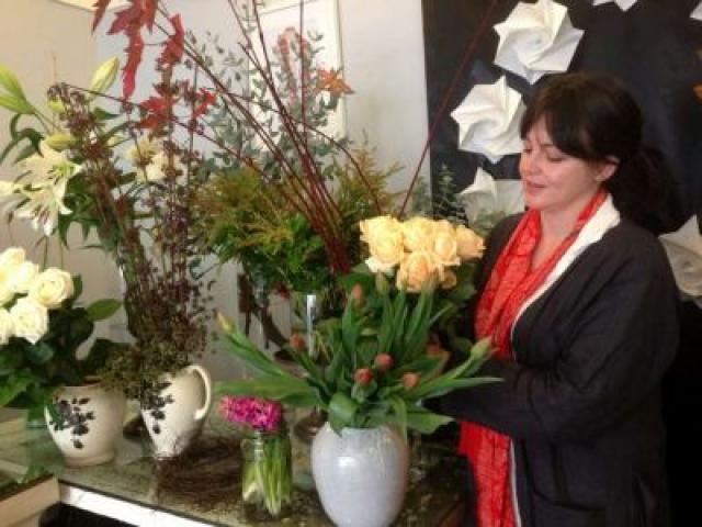 Jolene Wilkinson rearranges a display in her Moray Place boutique