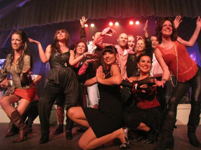 The cast of Rock and Roll Suicide takes a bow after the opening night performance at the...