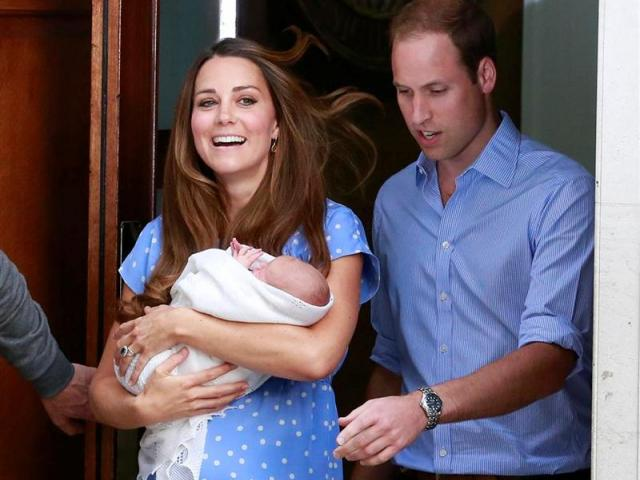 The Duke and Duchess of Cambridge emerge from St Mary's Hospital with their baby boy yesterday....