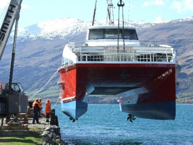 The Spirit of Queenstown is lowered into Lake Wakatipu at Kingston. Photo by Christina McDonald.