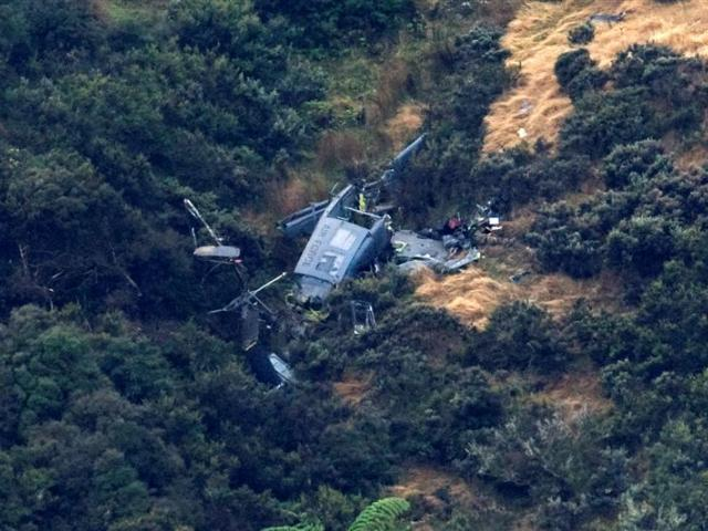The wreckage of the Air Force Helicopter on the side of a hill in Pukerua Bay in Wellington....