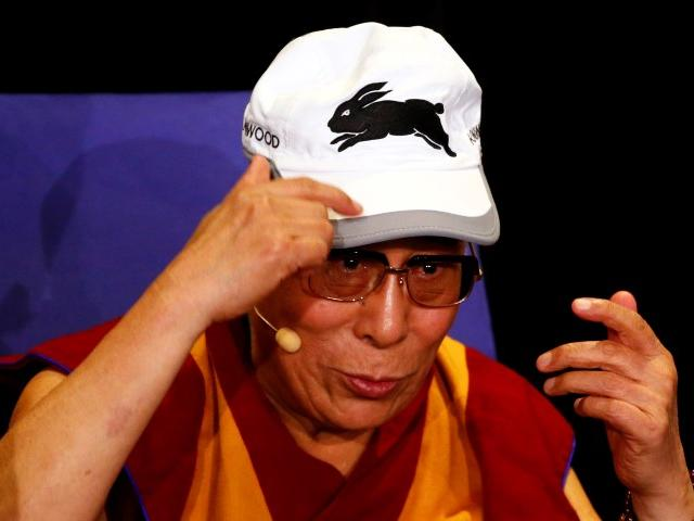 Tibetan spiritual leader the Dalai Lama wears a South Sydney Rabbitohs cap, which he was given,...