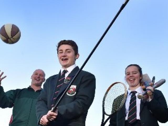 Head of sport Jeremy Scott and year 13 pupils Jesse Irvine (left) and Jess Chisholm (both 17)...