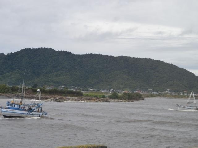 The Te Aroha is towed across the Grey River. Photo: Greymouth Star