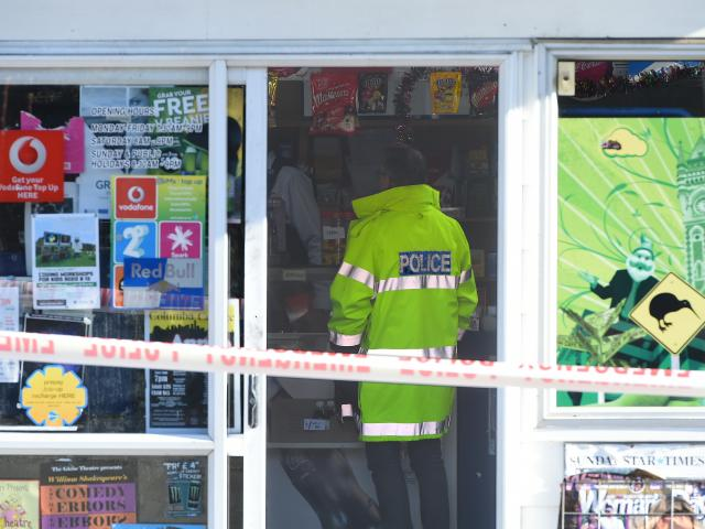 Police inside the Highgate Dairy yesterday. A masked man attempted to rob it at knife-point on 
