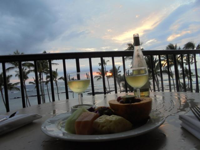 Tropical fruit and crisp white wine are flanked by a spectacular view from the Mauna Lani Resort,...