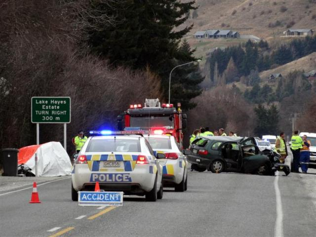 Emergency services at the scene following the crash. Photo by Tracey Roxburgh