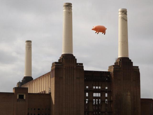 An inflatable pig flies above Battersea Power Station in a recreation of Pink Floyd's 'Animals'...