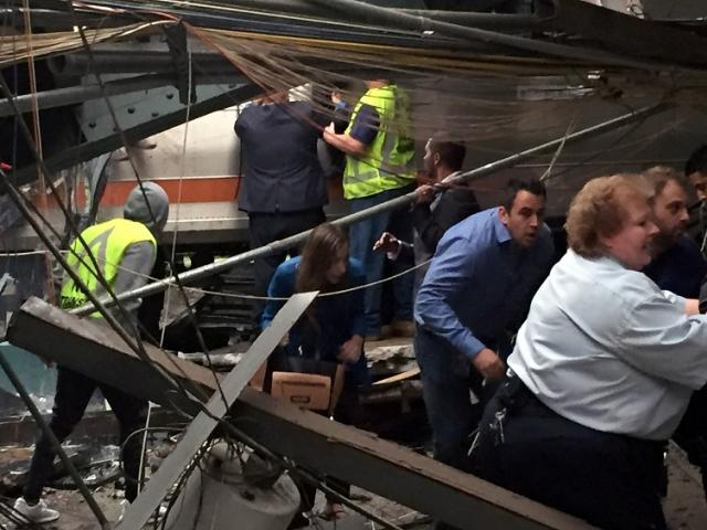 Passengers rush to safety after the train crashed in to the platform at the Hoboken station....