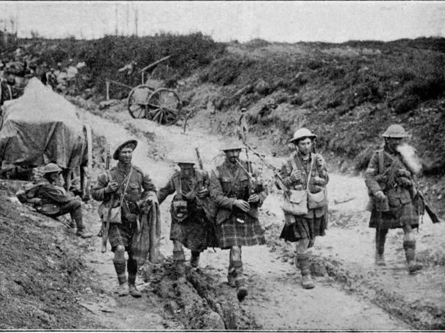 Highlanders returning from the trenches on the Somme, to the music of the bagpipes. - Otago...
