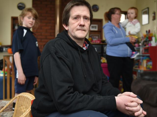 Aaron Mason (42), of Milton, contemplates the weekly struggle to provide for his family (from...