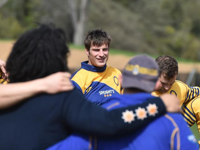 Paul Grant (centre) listens before the start of Otago training at Logan Park yesterday. Photo:...
