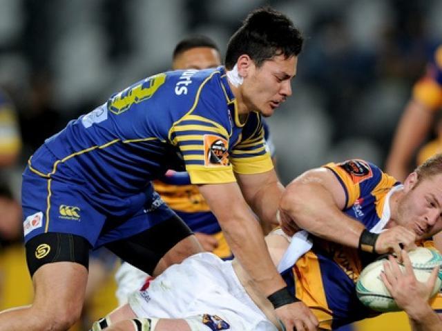 Sio Tomkinson of Otago tackles Sam Cane of Bay of Plenty. Photo: NZ Herald