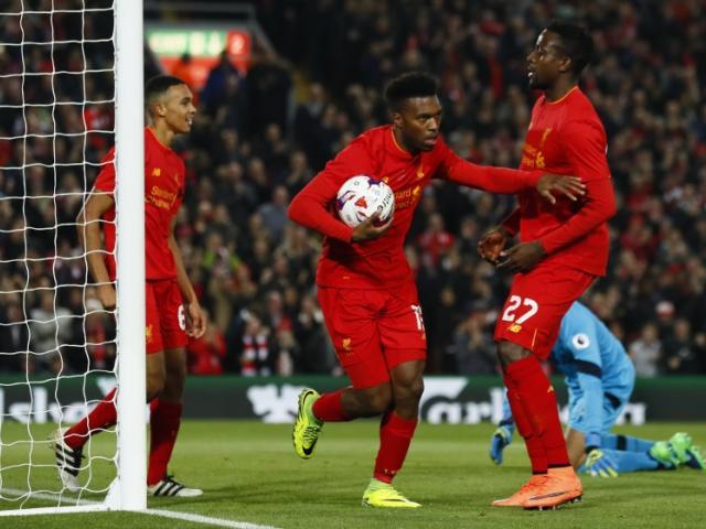 Daniel Sturridge (with ball) celebrates scoring Liverpool's first goal. Photo: Reuters