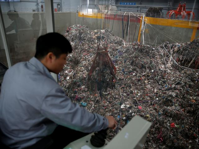 Employees work in the new waste-to-energy plant. Photo: Reuters