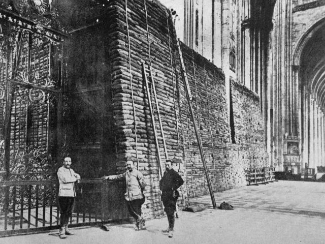 Amiens Cathedral, where sandbags are being used inside and out as screens and buffers in case of...