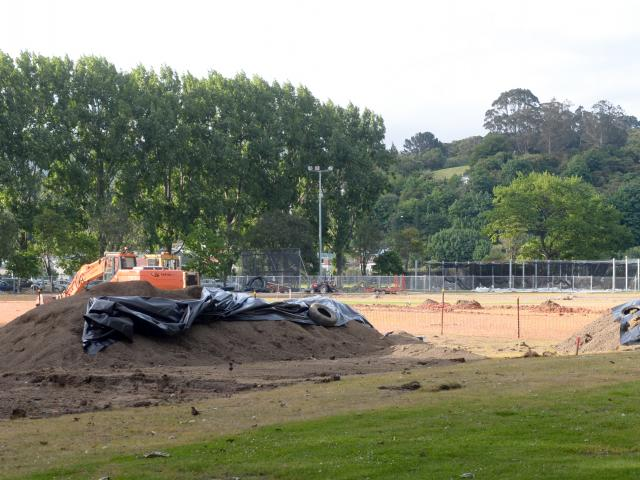 Plastic covers mounds of earth where  material thought to be asbestos was discovered at Dunedin's...