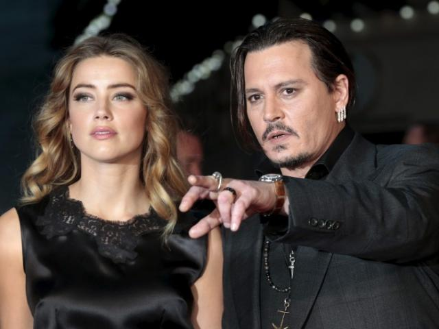 Amber Heard and Johnny Depp at a premiere last year. Photo: Reuters