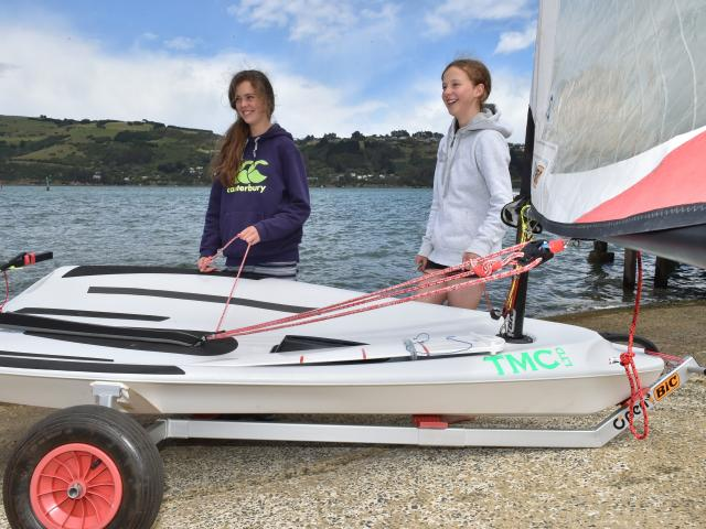 Anna Walrond (14, left) and Miriam Barton (13) rig an O'pen Bic dinghy for a sail on Otago...