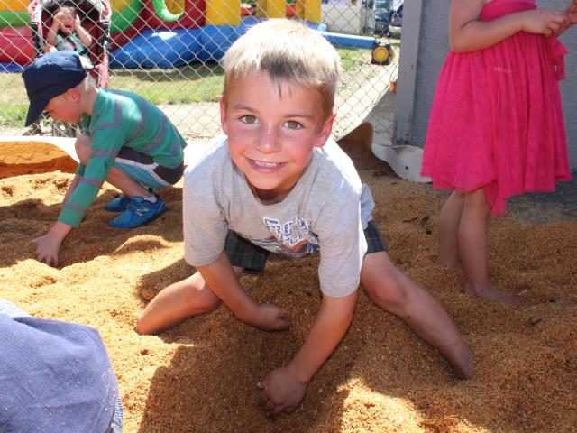 Balclutha boy Jacob Zwies (7) digs for treasure at Roxburgh's Mt Benger A&P Show on Saturday....