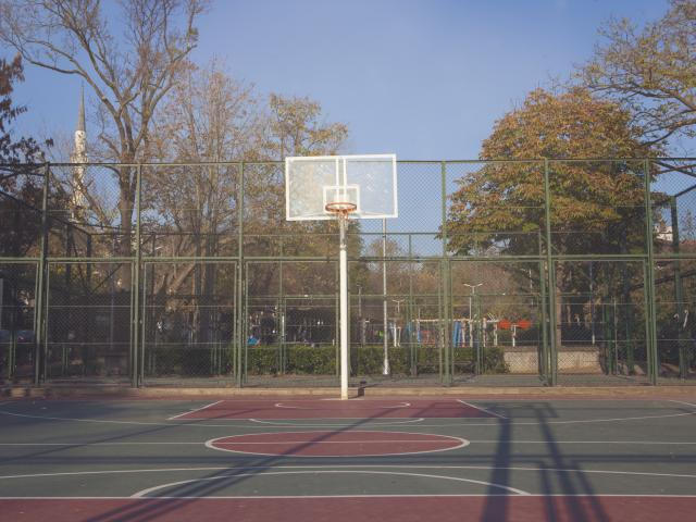 A man said he and his friends were sahot at while playing soccer in a basketball court in...