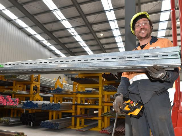 Storeman-distribution Phil Mattocks stocks shelves in Steel & Tube's new building. Photo:...
