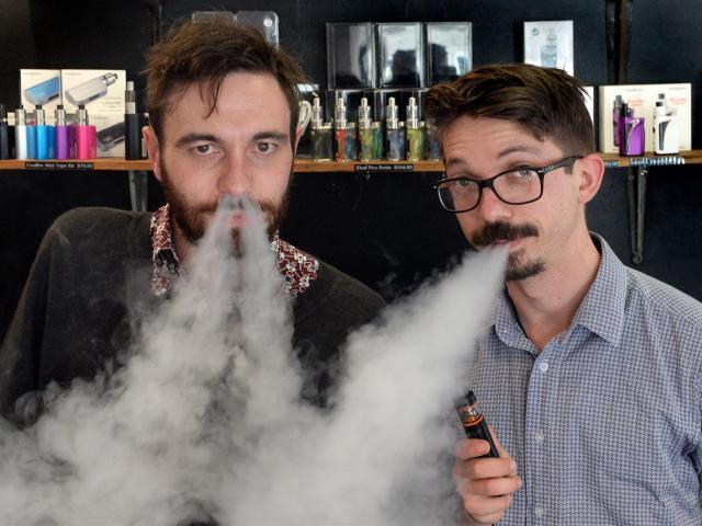 Dunedin e-cigarette store Vapourium account manager Cody Peneamene (left) and operations manager...