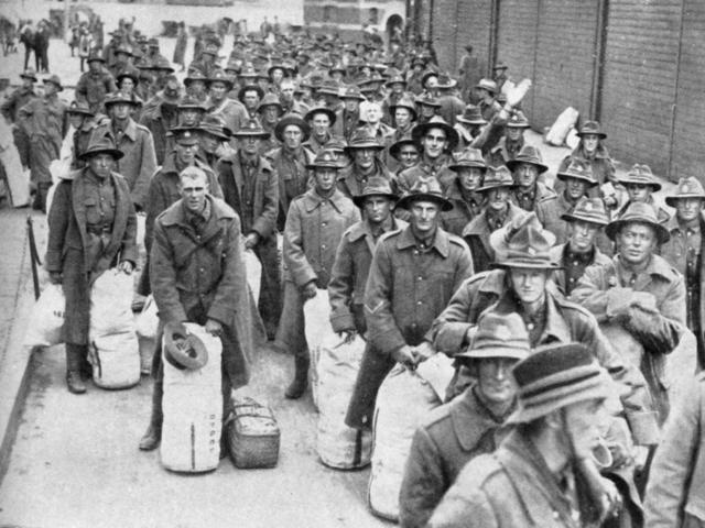 Men of the 24th Reinforcements, with their kitbags. — Otago Witness, 25.4.1917.