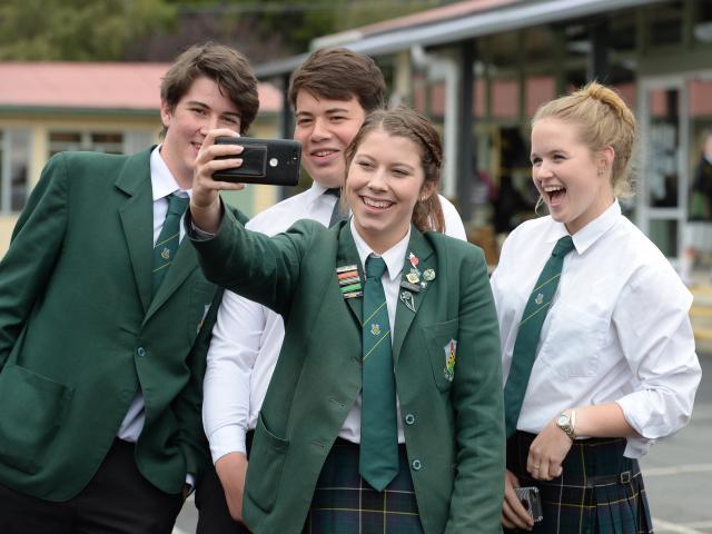 Taking a selfie together are East Otago High School pupils (from left) Jamie Dodd (17), Breeshyn Witehira (17), Hayley Jenkinson (16) and Nicole Bungard (17). Photo by Linda Robertson.