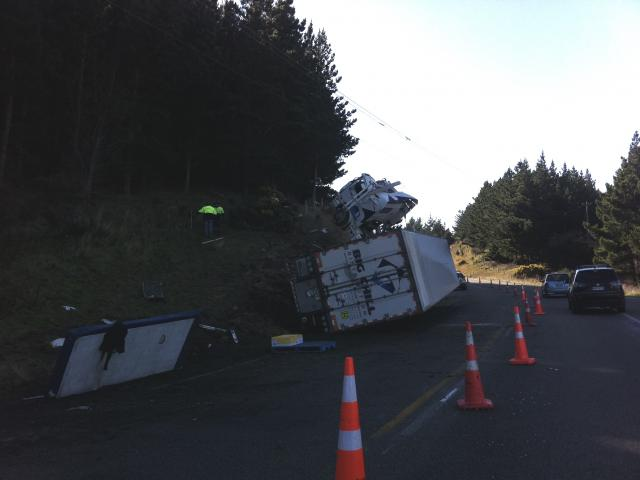 A man sustained minor injuries after the truck and trailer unit he was driving crashed after going off the road. Photo: Bruce Quirey