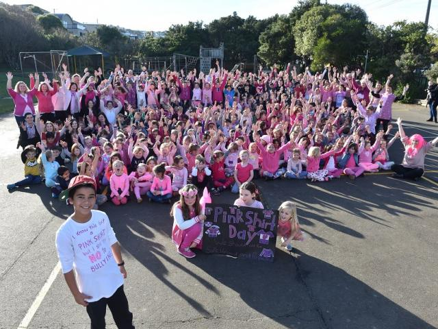 Tainui School pupil Corey Te Hei celebrates Pink Shirt Day with the rest of the school yesterday,...