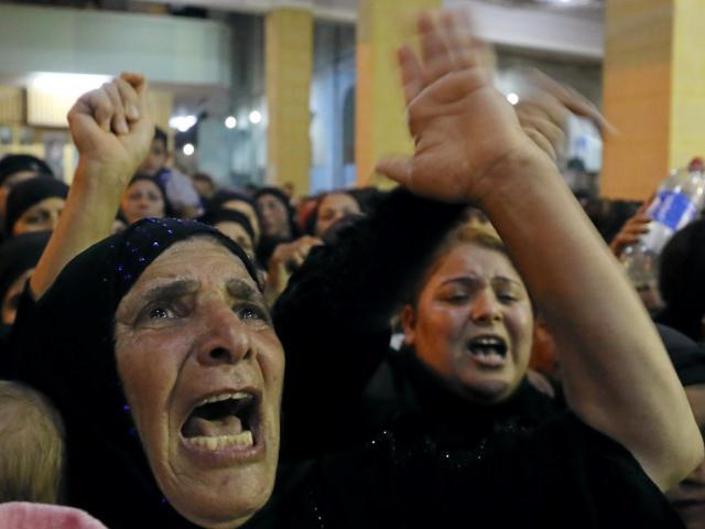 Relatives of victims killed in the attack grieve at the funeral in Minya, Egypt. Photo Reuters