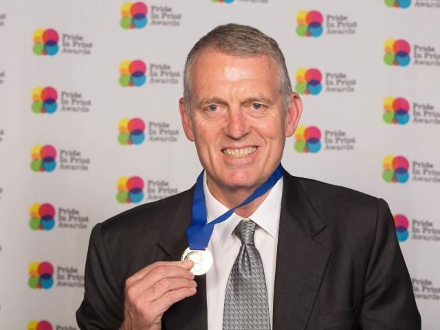 Southern Colour Print managing director Sean McMahon wears the medal his company received at the Pride In Print Awards.