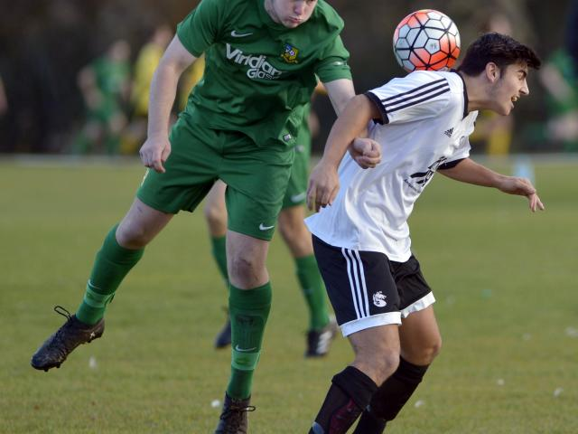 Green Island's Sam Dore (left) and Roslyn-Wakari's Tennessee Kinghorn compete for the ball at...