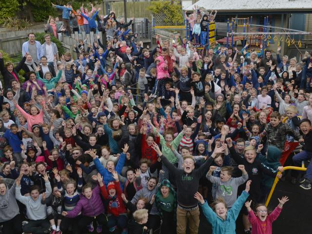 Kaikorai Primary School pupils and staff celebrate news the school will be rebuilt after...