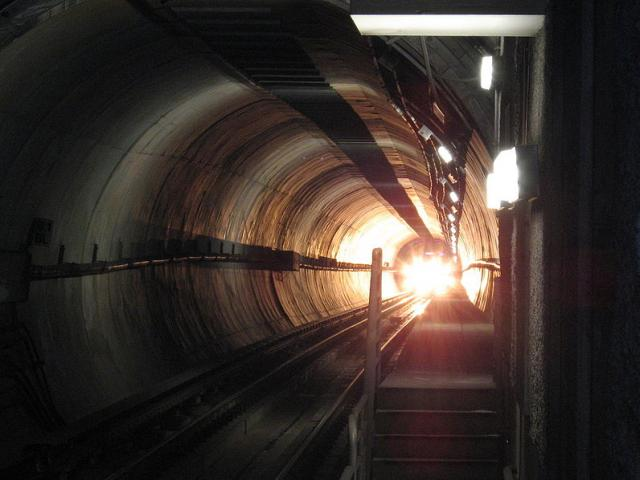 Light at the end of a tunnel. Photo by Wikimedia Commons.