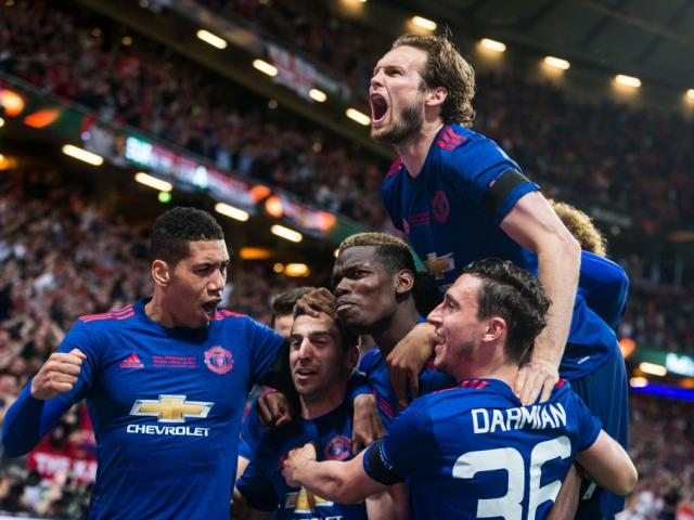 Henrikh Mkhitaryan, Chris Smalling, Matteo Darmian, Juan Mata, and Paul Pogba celebrate...