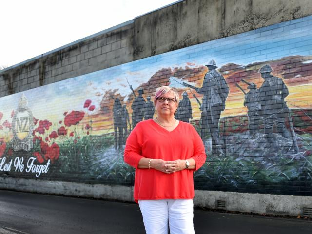 Diane Court at the new mural opposite Mosgiel RSA yesterday. Photos: Peter McIntosh.