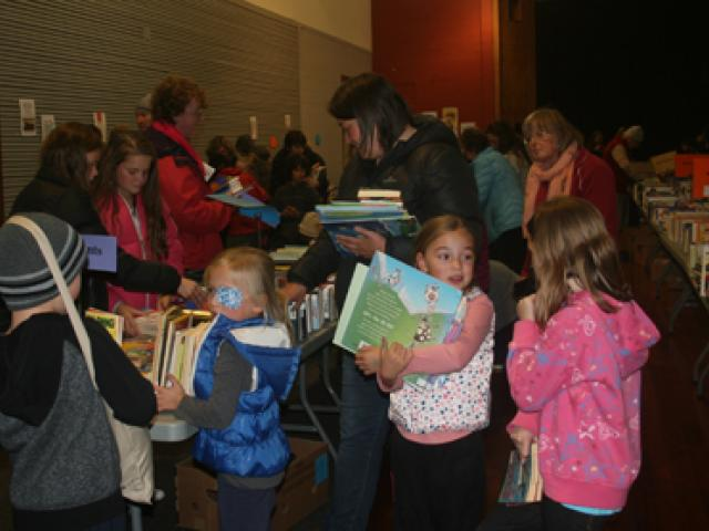 IMG 6861: Bargain hunters hunt for bargains on the Friday opening night with all ages scrambling...
