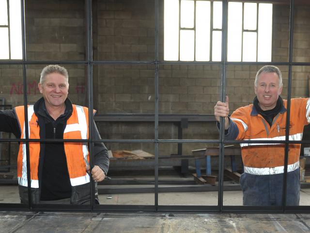Dirk Tuinman and Steve Hurring with a new window frame for the Cadbury World redevelopment, in...