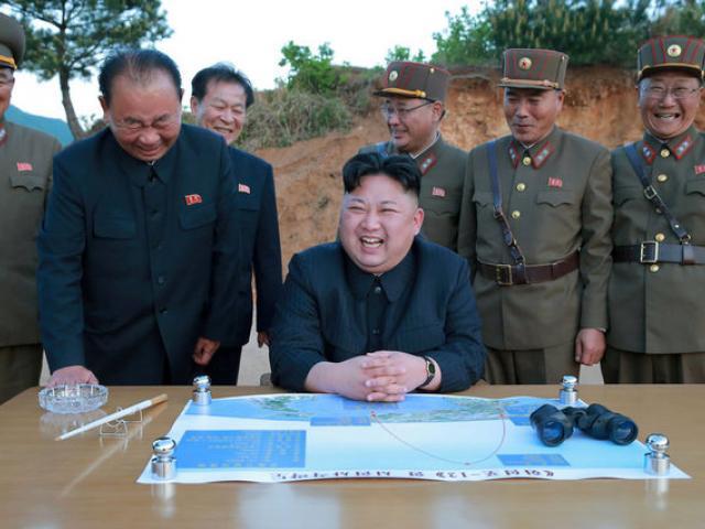 North Korean leader Kim Jong Un reacts during the long-range strategic ballistic rocket Hwasong...